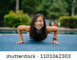 a young chinese asian woman s... | Shutterstock . vector #1101062303