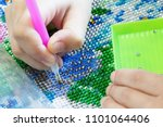 girl collect diamond painting.... | Shutterstock . vector #1101064406