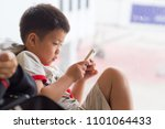 asian chinese boy playing... | Shutterstock . vector #1101064433