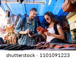 couple tourists looking at... | Shutterstock . vector #1101091223
