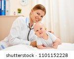 smiling baby girl in medical... | Shutterstock . vector #1101152228