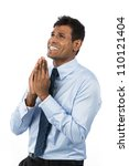 Indian business man praying for success. Isolate on white background. - stock photo