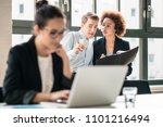 two young malicious employees... | Shutterstock . vector #1101216494