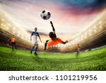 soccer striker hits the ball... | Shutterstock . vector #1101219956