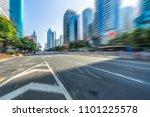 city road through modern...   Shutterstock . vector #1101225578