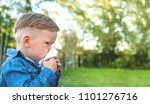 little boy sneezing with tissue ...   Shutterstock . vector #1101276716