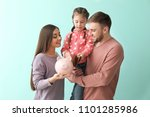 happy young family with piggy... | Shutterstock . vector #1101285986