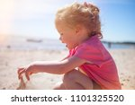 little  girl l at the beach... | Shutterstock . vector #1101325520