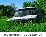 rusty  broken car car stands in ... | Shutterstock . vector #1101328409