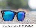 blue sunglasses on white sand... | Shutterstock . vector #1101330260