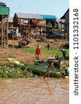 Small photo of TONLE SAP FLOATING VILLAGE, CAMBODIA, MARCH 2018; 80,000 souls live on the river and of lake of Tonle Sap. Malaraia and Denge fever are rife, average life expectancy is 54 years.