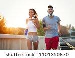couple jogging outdoors | Shutterstock . vector #1101350870