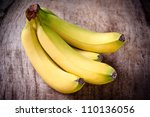 fresh bananas on wooden... | Shutterstock . vector #110136056