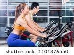 sportive asian couple doing... | Shutterstock . vector #1101376550