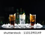 two whisky and coke cocktails... | Shutterstock . vector #1101390149