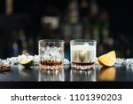 two glasses of alcoholic drinks ... | Shutterstock . vector #1101390203