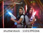 girls standing back to back in... | Shutterstock . vector #1101390266