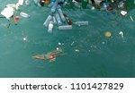 rubbish in the ocean sea water  | Shutterstock . vector #1101427829