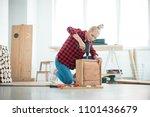 indoor shot of young woman... | Shutterstock . vector #1101436679