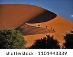 dunes from the red sand of the... | Shutterstock . vector #1101443339