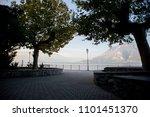 morning silhouette of trees on... | Shutterstock . vector #1101451370