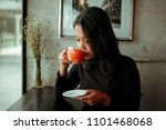asian woman drinking coffee... | Shutterstock . vector #1101468068