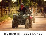 rally on buggies and quad bikes   Shutterstock . vector #1101477416