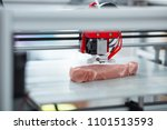 Small photo of Absolutely alike. The close up of a 3D printer recreating a piece of meat, imitating all the little details