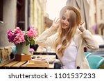 pretty blonde girl eat her... | Shutterstock . vector #1101537233