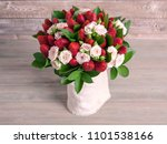 Stock photo delicious bouquet of strawberries and roses close up 1101538166