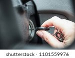the girl starts the car by... | Shutterstock . vector #1101559976