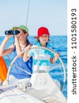 boy captain with his sister on... | Shutterstock . vector #1101580193