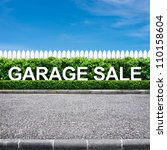 Small photo of Garage sale sign on the road side
