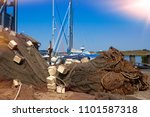 fishing gear in harbor | Shutterstock . vector #1101587318