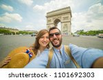 happy couple travel in paris... | Shutterstock . vector #1101692303