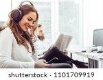 businesswoman with headphones... | Shutterstock . vector #1101709919
