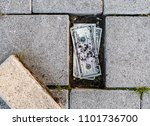 us dollar bills found under a... | Shutterstock . vector #1101736700