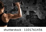 athletic woman training biceps... | Shutterstock . vector #1101761456
