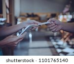 man using a credit card to pay... | Shutterstock . vector #1101765140