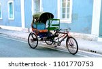a rickshaw in the streets of... | Shutterstock . vector #1101770753