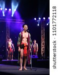 """Small photo of Udonthani, Thailand ; May 27, 2018 - Male Contestants for Beauty Handsome Pageant contest in Local Thai style, walk on Final Stage at Central Hall for """"Mister Star Thailand 2018 E-sarn"""""""