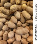 Fresh And Raw Potatoes With...