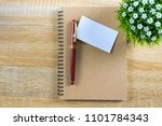 Small photo of Blank business card or name card with space for add text name address and logo with notebook organizer on working table, financial company concept idea. top view.