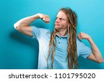 Small photo of Powerful young man in a success flex pose on a solid background