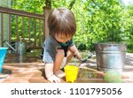 young toddler boy playing with... | Shutterstock . vector #1101795056