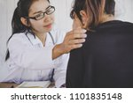 asian female doctor comforting... | Shutterstock . vector #1101835148
