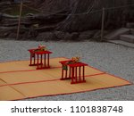 Stock photo ceremonial hand bells for a wedding ritual on small tables with reed mat on gravel in courtyard of 1101838748