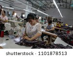 Small photo of Nam Dinh , Viet Nam -June 20 , 2017 : Workers work in a garment factory in Nam Dinh town,Viet Nam