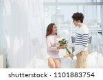smiling vietnamese man giving... | Shutterstock . vector #1101883754