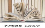 opened book close up in a library - stock photo